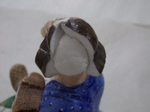 Tête d'une statuette en porcelaine